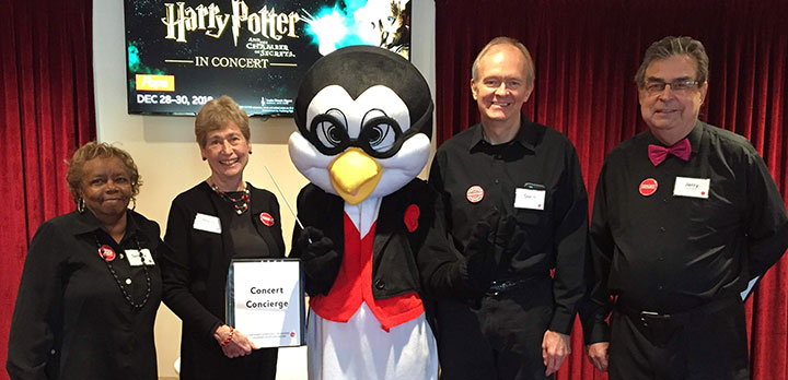 Pops mascot Tempo the Penguin poses with CSO volunteers