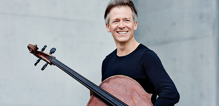 Cellist Alban Gerhardt holding his cello