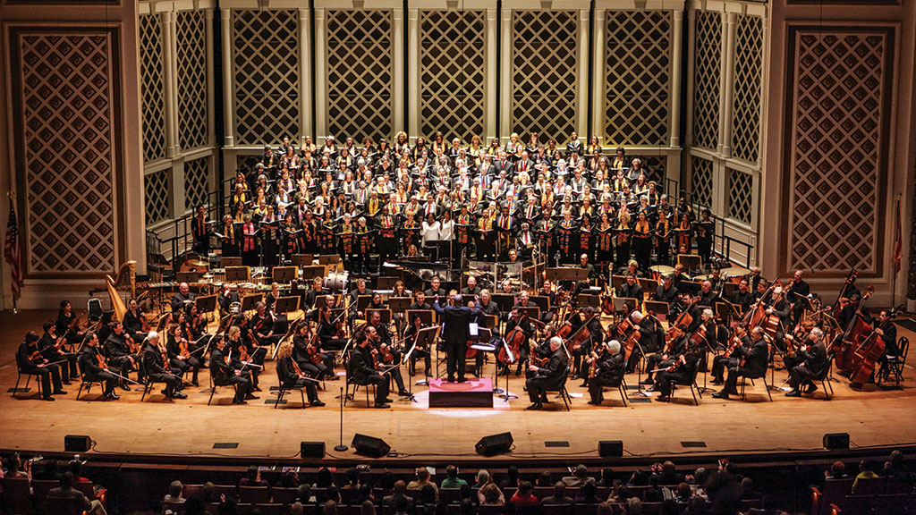 CSO and Classical Roots Choir performing on stage during a concert