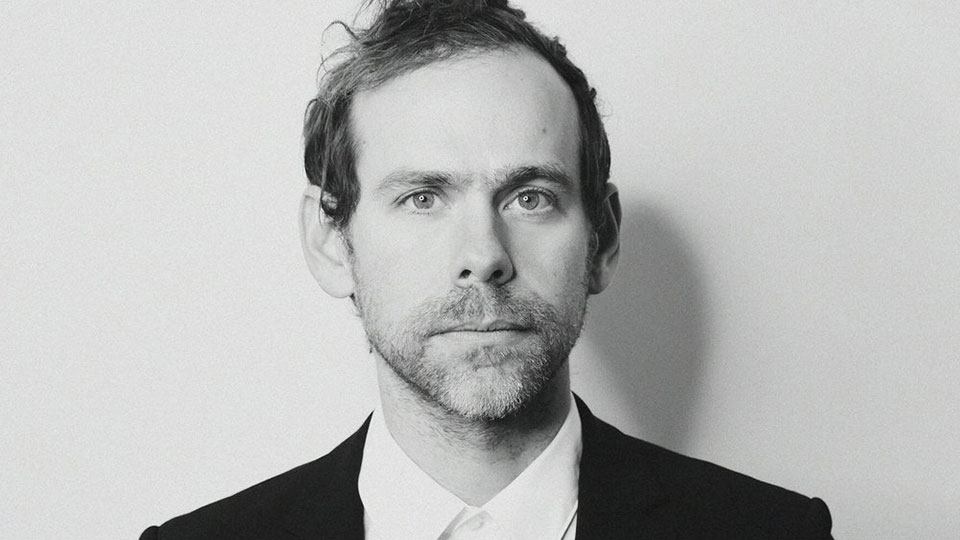Headshot of composer Bryce Dessner