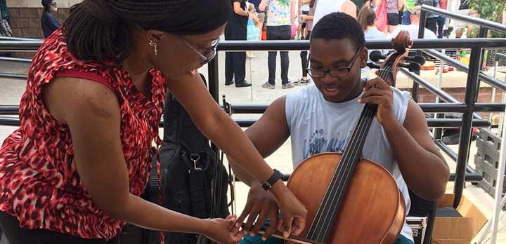 A Music Lab shows a guest how to play a cello