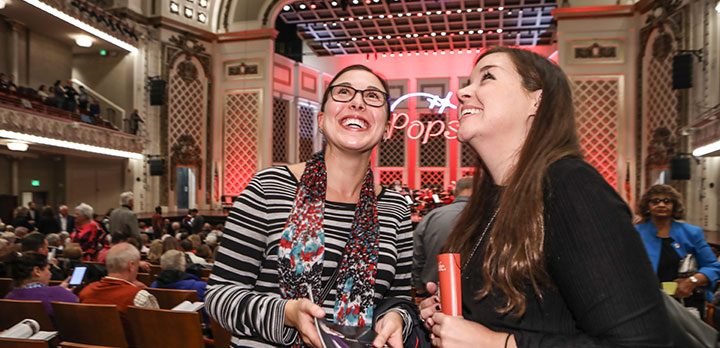 Two concertgoers marvel at Music Hall auditorium